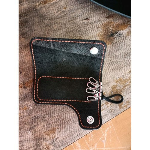 Key holder with small knife